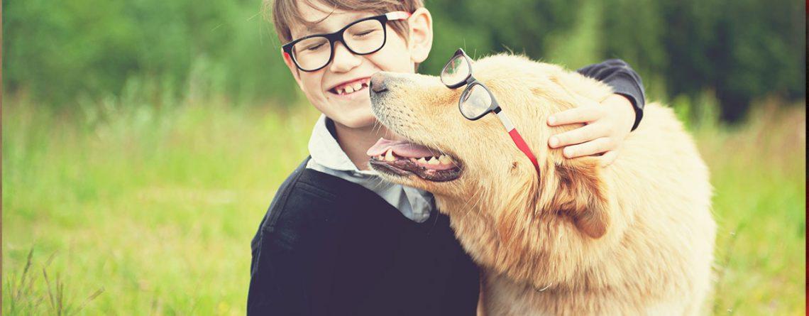 boy in school uniform hugs dog